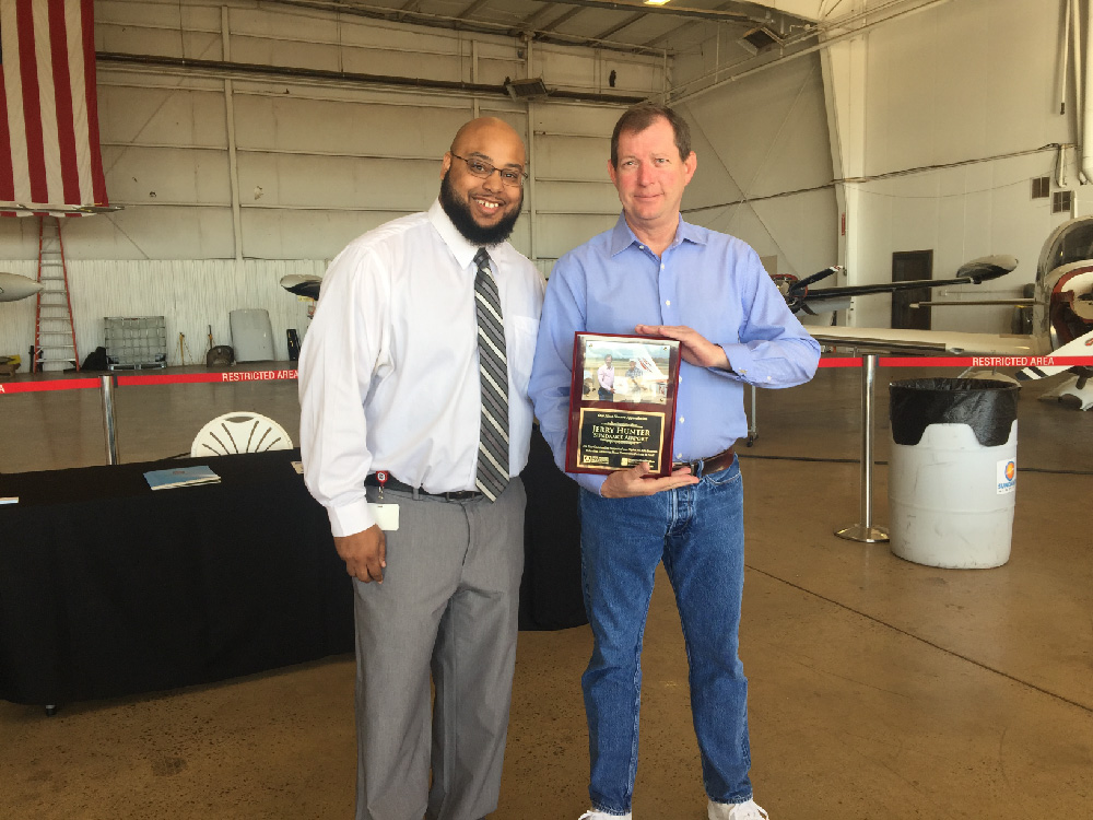 Carvin Brown gives Jerry Hunter an Award of Appreciation for everything he has done to help Flights For Life and OBI.